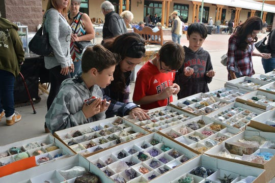 Children look at rocks during the annual The Museum ROCKS! Gem & Mineral Show at the New Mexico Farm & Ranch Heritage Museum.