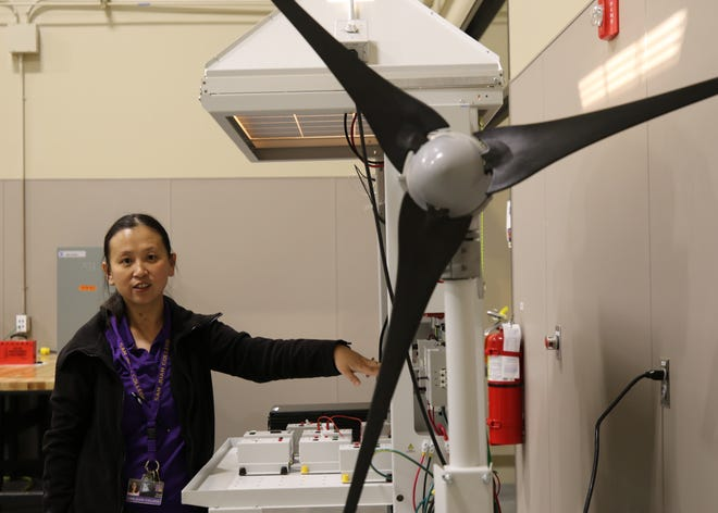 Qinqin Schoser demonstrates a new tool, Thursday, Feb. 14, 2019, that will help train students to work in renewable energy fields.