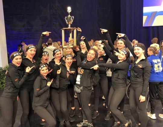 Members of the Northville High School junior varsity dance team celebrate their recent success in Orlando.
