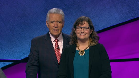 Amanda Holm of Livonia stands with Alex Trebek after she won Feb. 15.