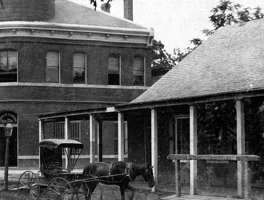Charles Ealer building as it sat on Ealer's Corner during the late 1890s. Across Main Street in the photo is the St. Landry State Bank on King's Corner.