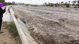 The wash in Palm Springs between Gene Autry Trail and Escoba Drive is filled to the brim with fast-moving water February 14, 2019.
