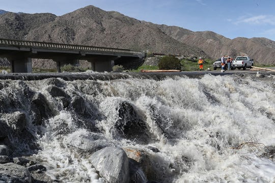 Water continues flowing over Highway 111 at Chino Creek in Palm Springs, February 15, 2019. A Feb. 14 storm that delivered 3.71 inches of rain to Palm Springs in a 24-hour period brought major road closures due to flooding and damage, such as this on Highway 111.