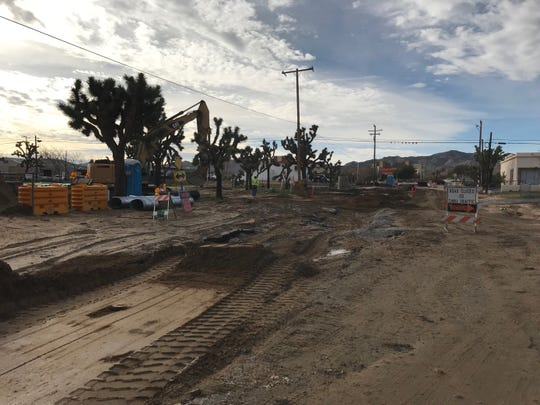 The plan was to lay a sewer line on this road but now cleanup crews are here due to the storm — Palm Avenue and Antelope Trail in Yucca Valley on Feb. 15, 2019.