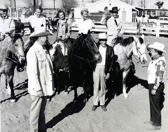 The swearing in of Jane Hoff January 1970.  Jane is seen mounted (second from left). Standing below (right to left): Jane's husband Boo Hoff, her father Carl Lykken, and Mayor Ed McCoubrey.