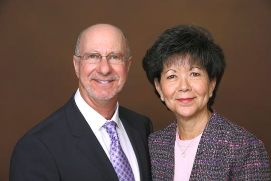 Paul D. Golden, chairman of the board of directors of CancerPartners, and Maria Elena Geyer, president and CEO.