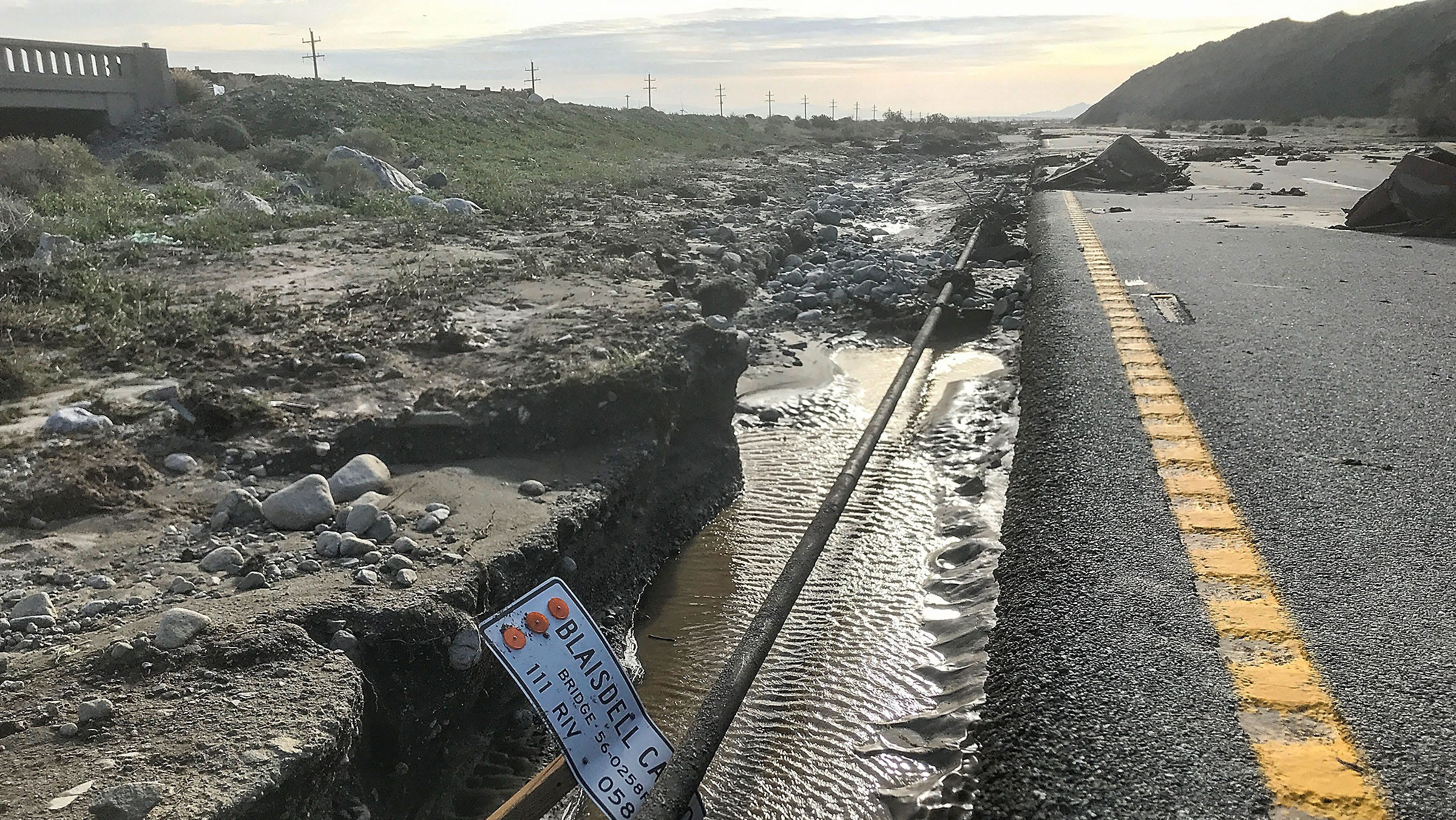 Rain closes Highway 111 in Palm Springs; cars buried in mud