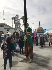 A performer outside the Indio Fairgrounds, dressed up for the National Date Festival.