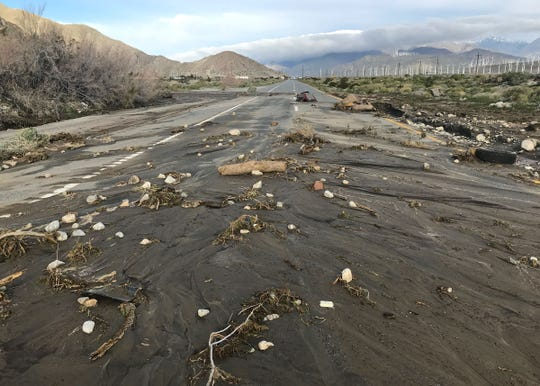 Mud and debris covers eastbound Highway 111 near Overture Drive were washed away by rain water in Palm Springs, February 15, 2019.