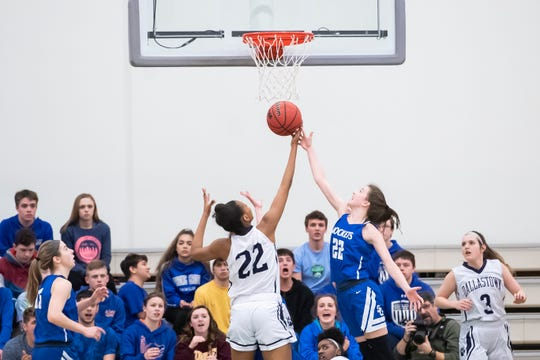 Dallastown's Aniya Matthews, left, and Spring Grove's Ella Kale vie for a rebound in the YAIAA girls' championship game at Charles Wolf Gym at York College Thursday, February 14, 2019. The Wildcats won 36-26.