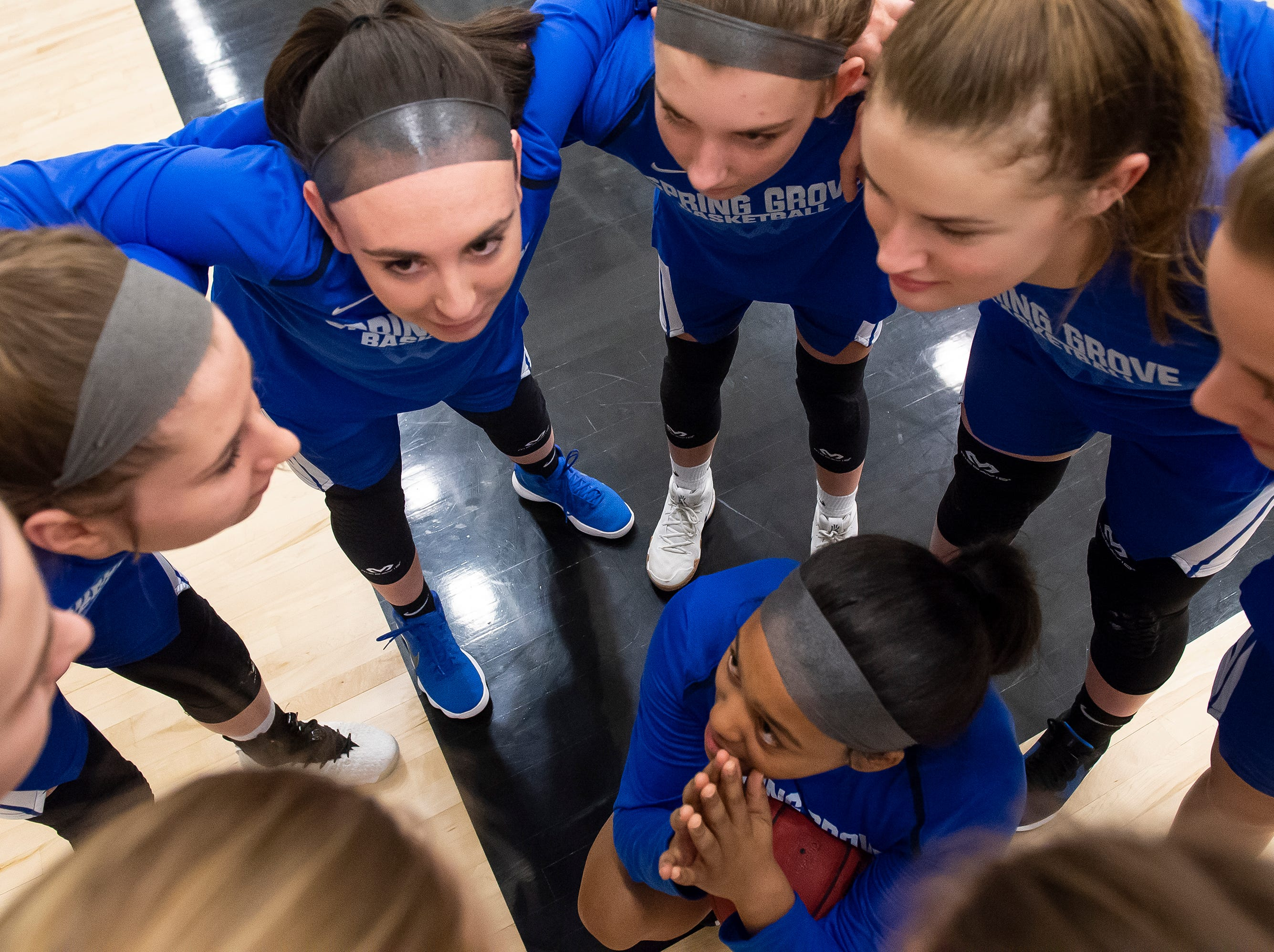The Spring Grove Rockets huddle up prior to the YAIAA girls' championship game at Charles Wolf Gym at York College Thursday, February 14, 2019.