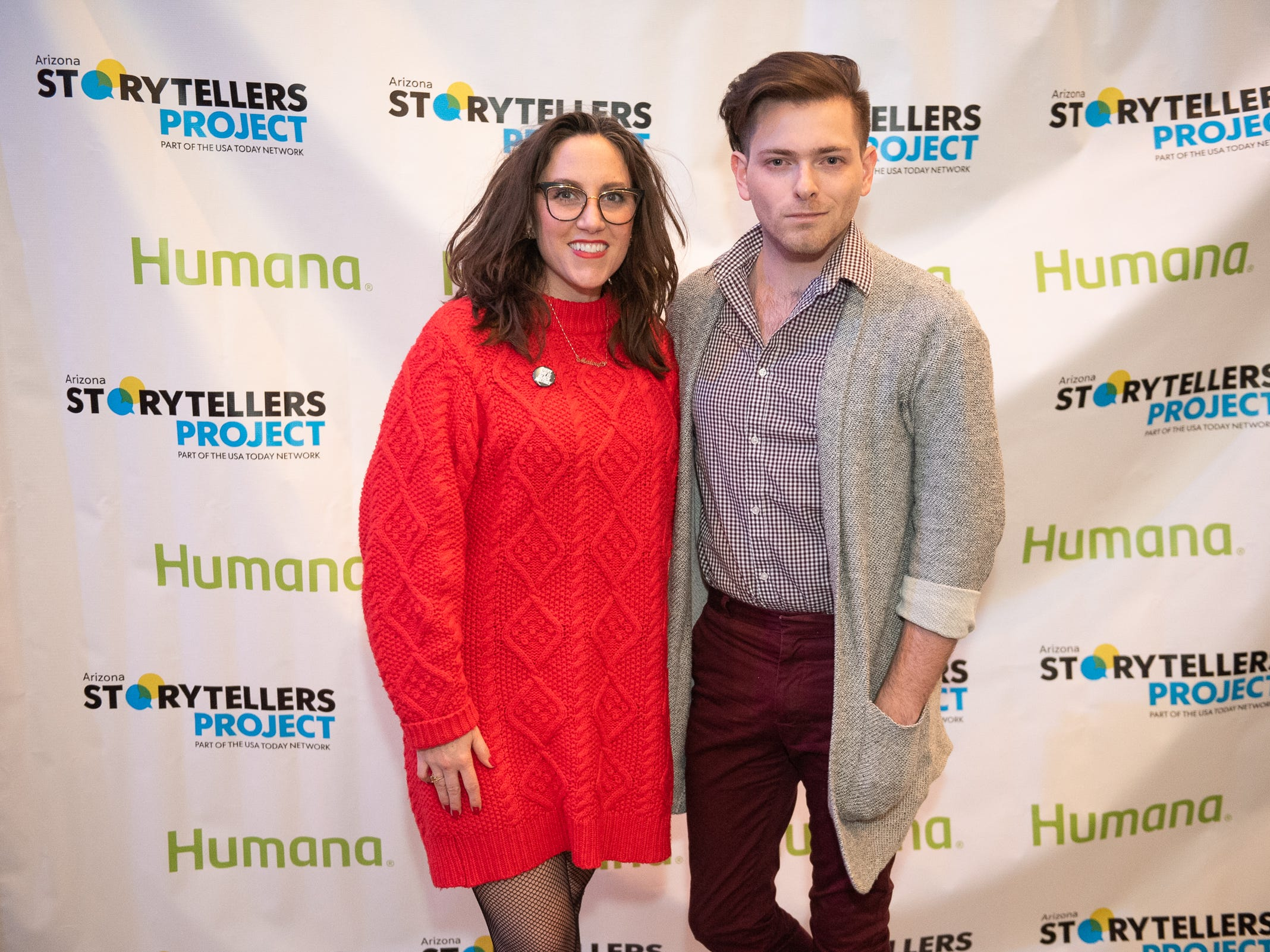"""Co-hosts Megan Finnerty and Garrett Mitchell strike a pose at the Humana/Storytellers Project step and repeat during """"Arizona Storytellers: Romance or Not"""" at the Scottsdale Center for Performing Arts on Wednesday, Feb. 13, 2019."""