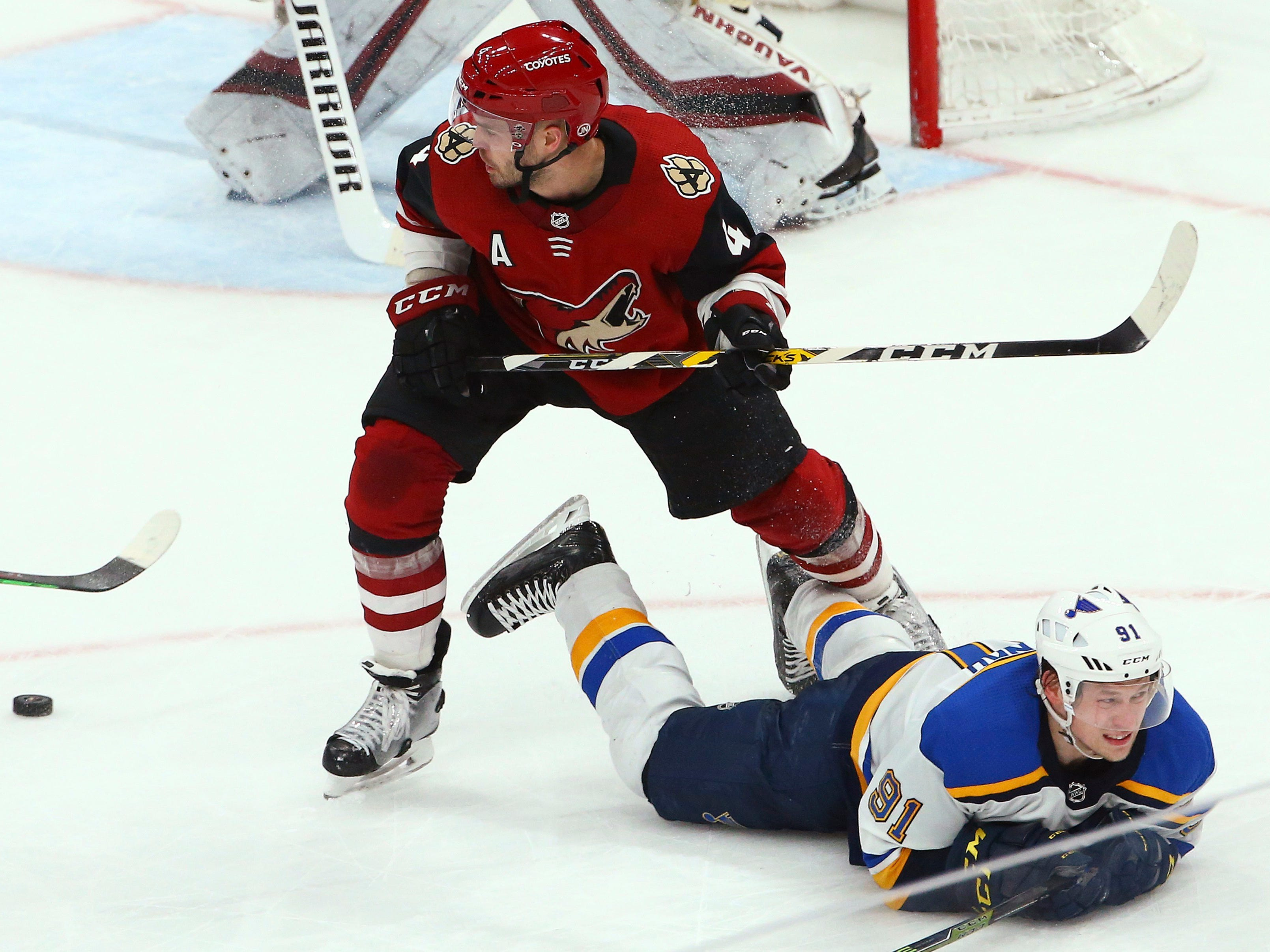 Arizona Coyotes defenseman Niklas Hjalmarsson (4) sends St. Louis Blues right wing Vladimir Tarasenko (91) to the ice during the second period of an NHL hockey game Thursday, Feb. 14, 2019, in Glendale, Ariz.