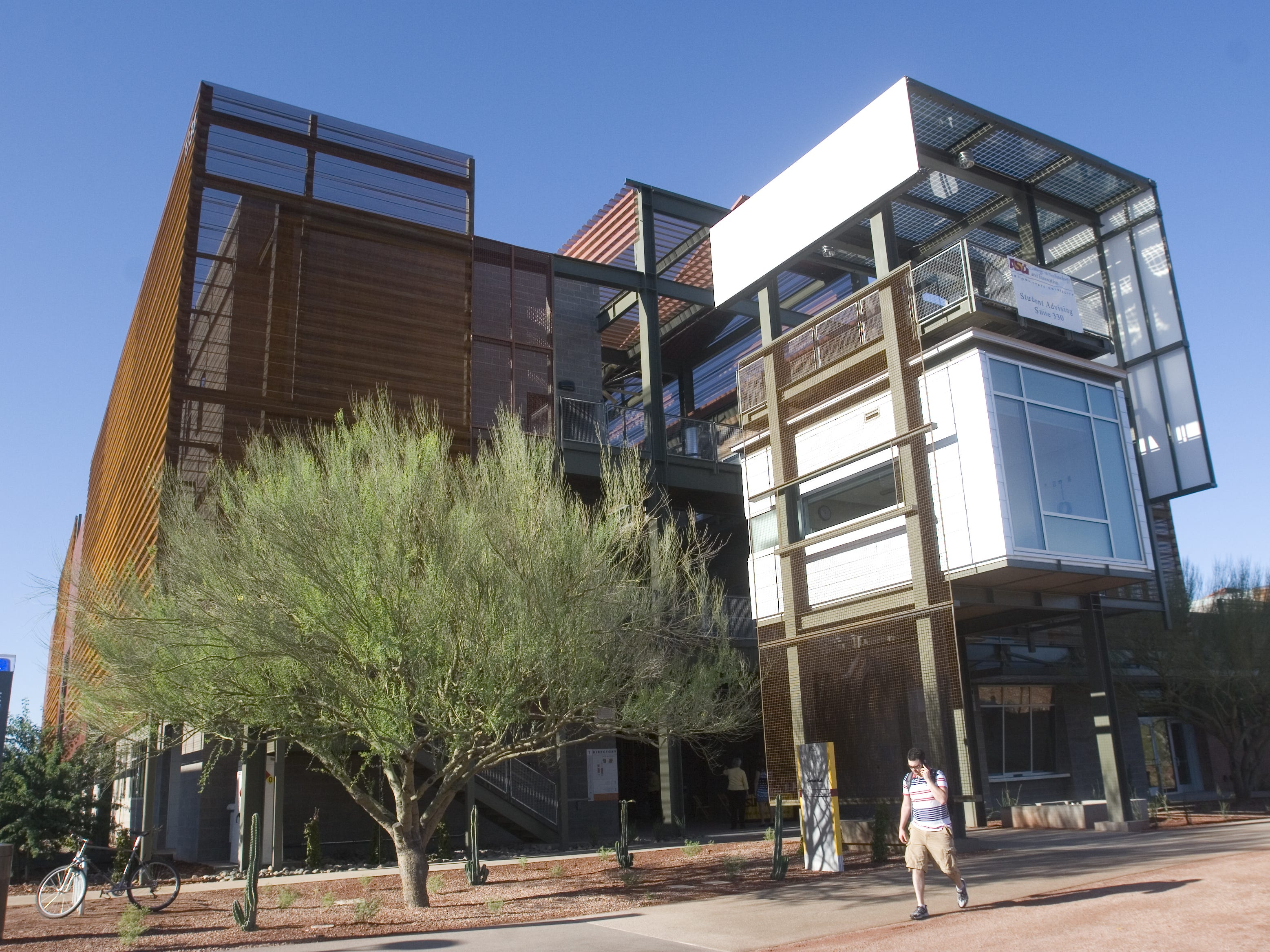 A student walks past Peralta Hall, one of several new buildings that opened at the ASU Polytechnic Campus in Mesa, as seen on Sept. 11, 2008.