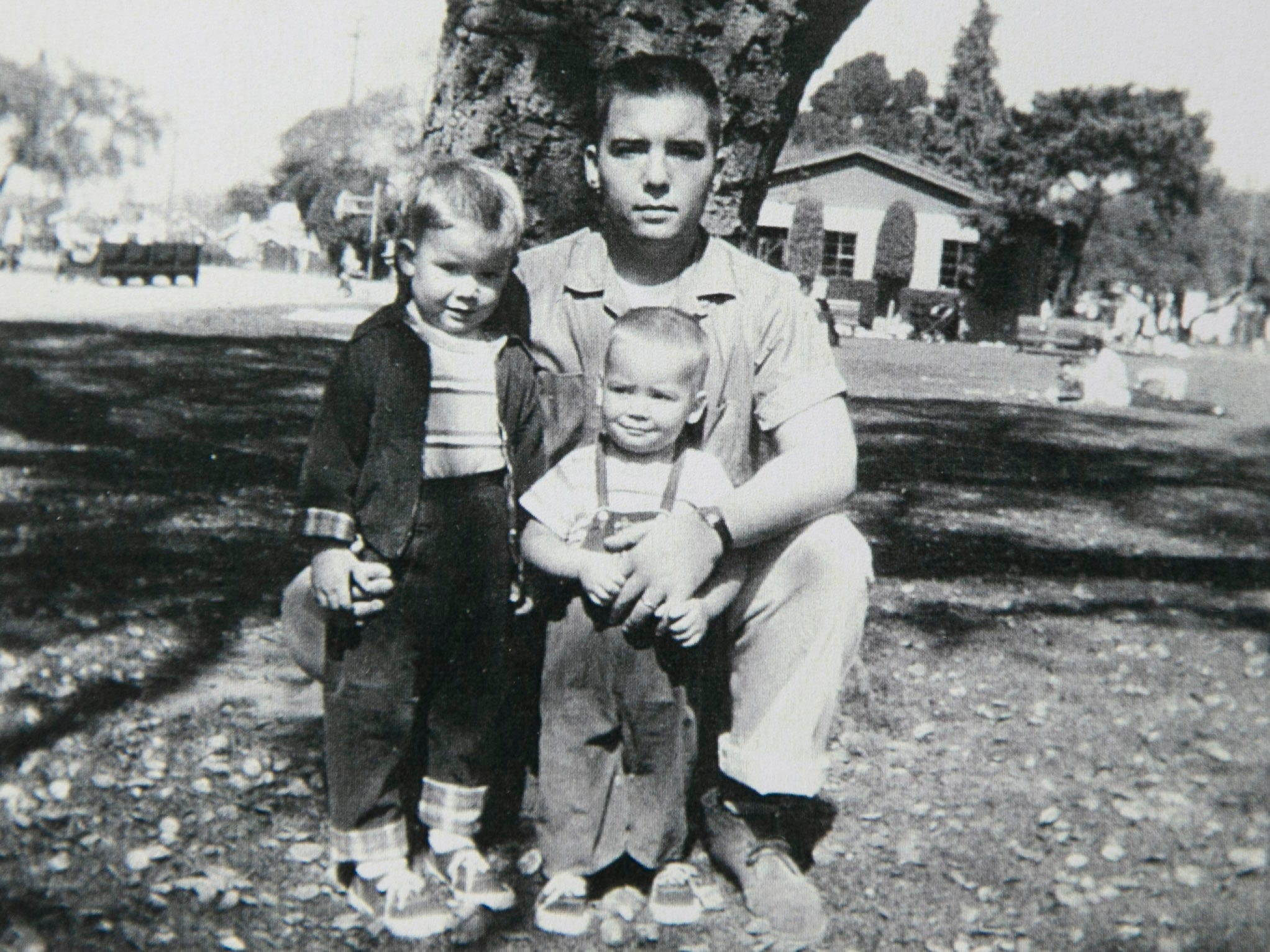 Michael Crow (left) with his father, George, and brother, David, in Memphis, Tennessee, in 1958.