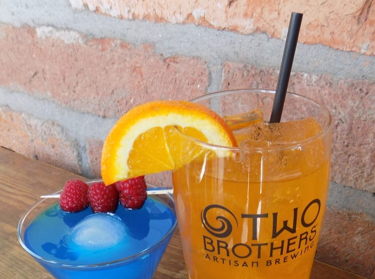 TWO BROTHERS TAP HOUSE & BREWERY: Get a freeappetizer with the purchase of any entree on dine-in orders. Try spring training cocktails likethe Cubbie Cosmo ($6) made with Two Brothers Vodka, blue curacao, white cranberry juice and lime juice; or theGiants Juice ($6) made withTwo Brothers Gin, orange liquor, lime juice, orange juice and a splash of 7UP.