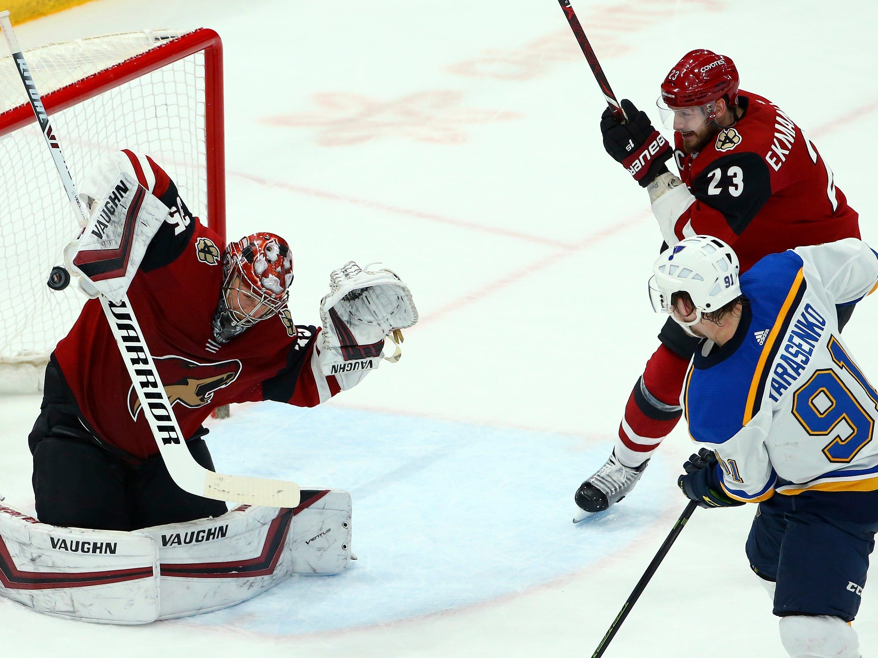 St. Louis Blues right wing Vladimir Tarasenko (91) sends the puck past Arizona Coyotes goaltender Darcy Kuemper, left, for a goal as Coyotes defenseman Oliver Ekman-Larsson (23) watches during the first period of an NHL hockey game Thursday, Feb. 14, 2019, in Glendale, Ariz.