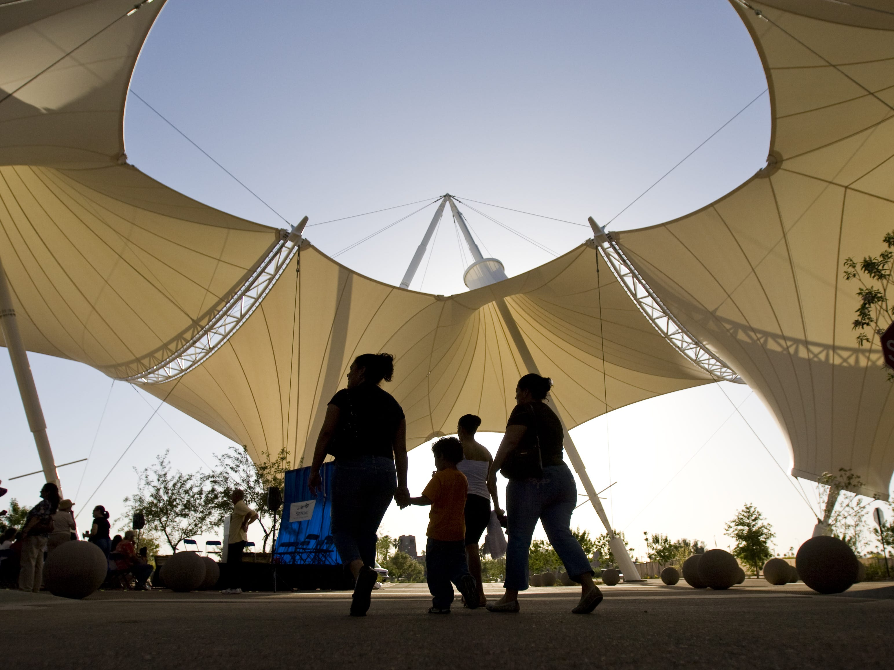 People walk under shade structures at SkySong Center at the ASU Scottsdale Innovation Center during dedication ceremonies in Scottsdale on April 29, 2009. In 2008, after two years of construction, the first two buildings at SkySong opened.