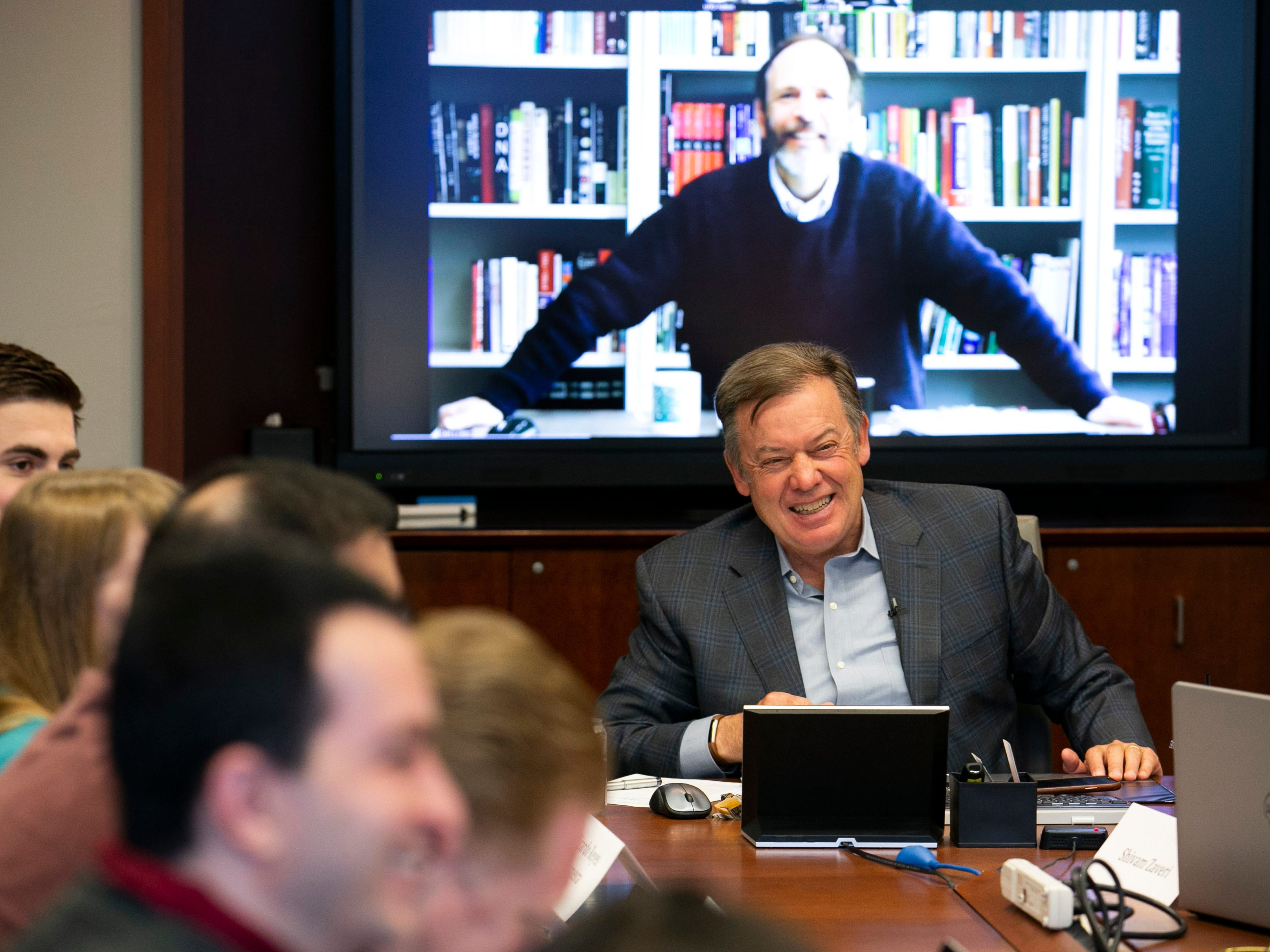 ASU President Michael Crow smiles while co-teaching the multi-disciplinary Science, Technology and Public Affairs class with Dan Sarewitz via a video-conference to ASU doctoral, masters and undergraduate students at the Fulton Center at ASU in Tempe on Jan. 30, 2019.
