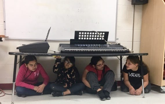 A voice came over the speaker at Sunnyslope School in Phoenix announcing a lockdown drill. Without being told, the students slid under tables and sat hunched, cross-legged and (mostly) quiet.