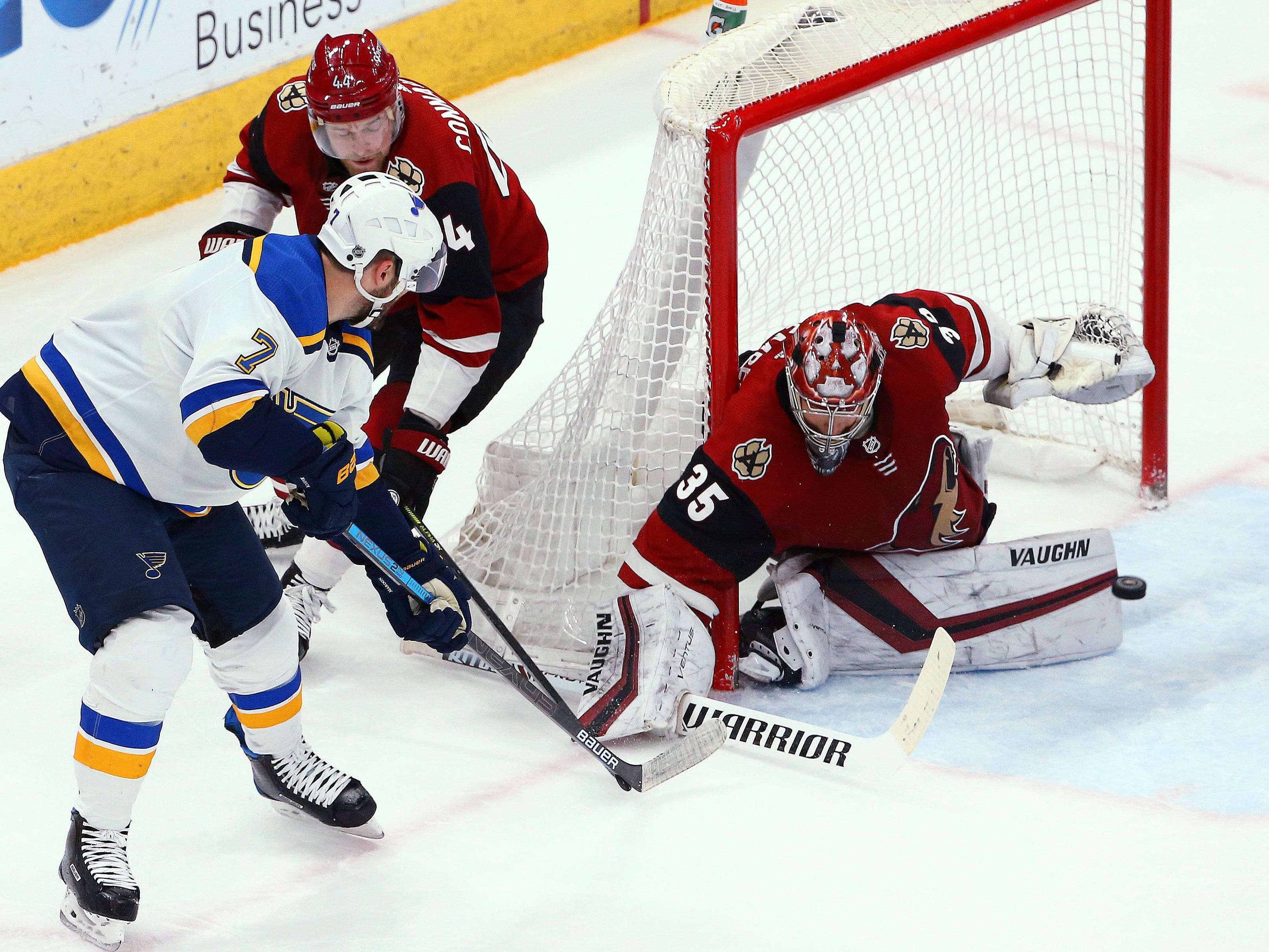 Arizona Coyotes goaltender Darcy Kuemper (35) makes a save on a shot by St. Louis Blues left wing Pat Maroon (7) as Coyotes defenseman Kevin Connauton (44) applies pressure during the first period of an NHL hockey game Thursday, Feb. 14, 2019, in Glendale, Ariz.