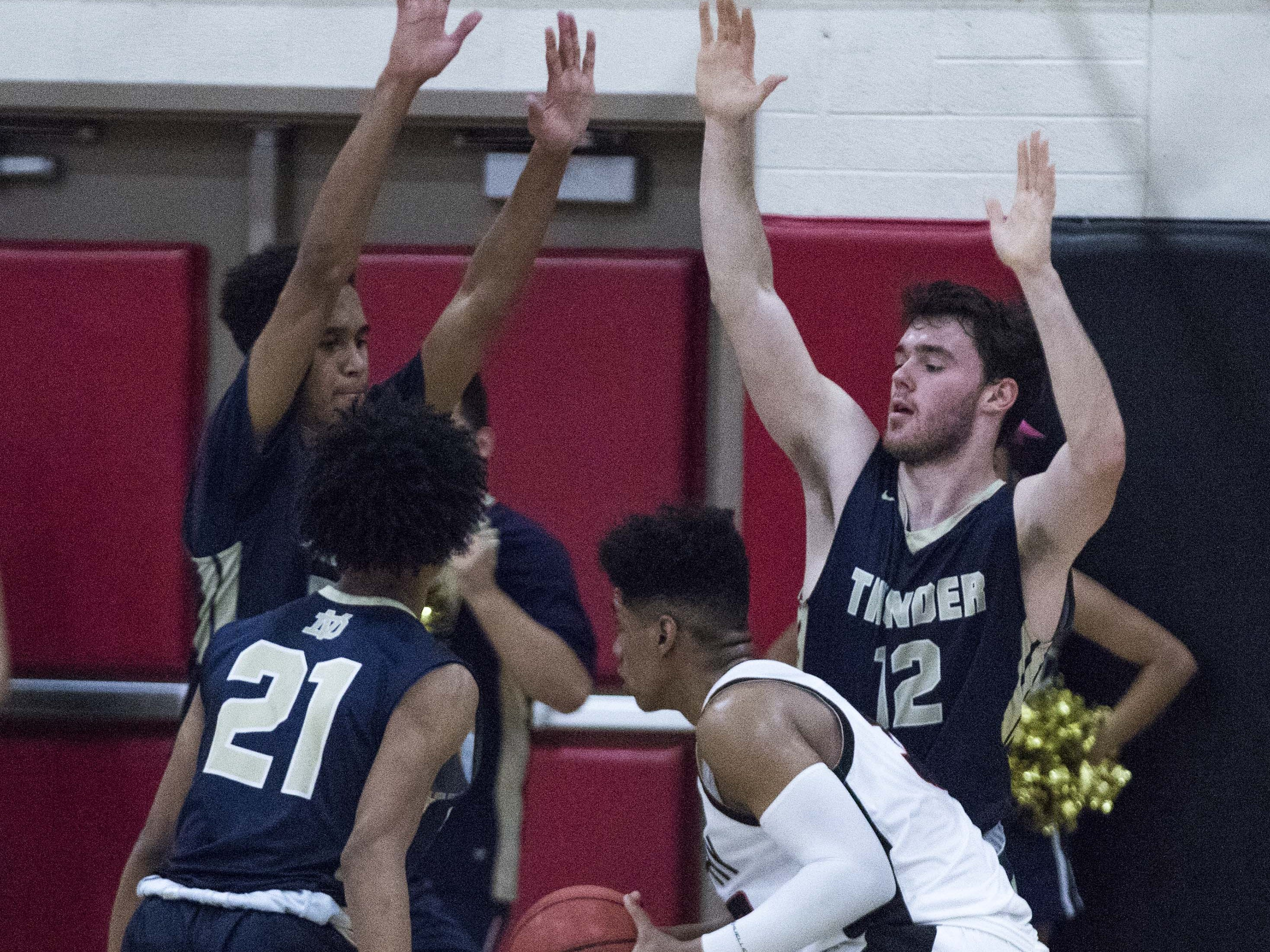Desert Vista plays tough defense on Brophy's Joe Feeney (32) during the first half of their game in Phoenix, Thursday, Feb .14,  2019.