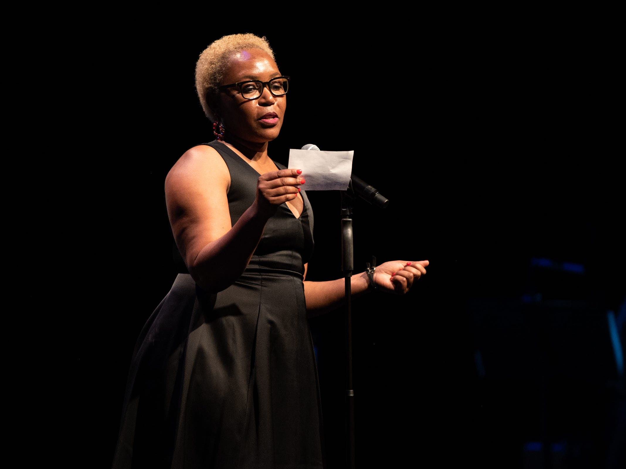 """Kanu Jacobsen tells her tale of romance during """"Arizona Storytellers: Romance, or Not"""" at the Scottsdale Center for Performing Arts on Wednesday, Feb. 13, 2019."""