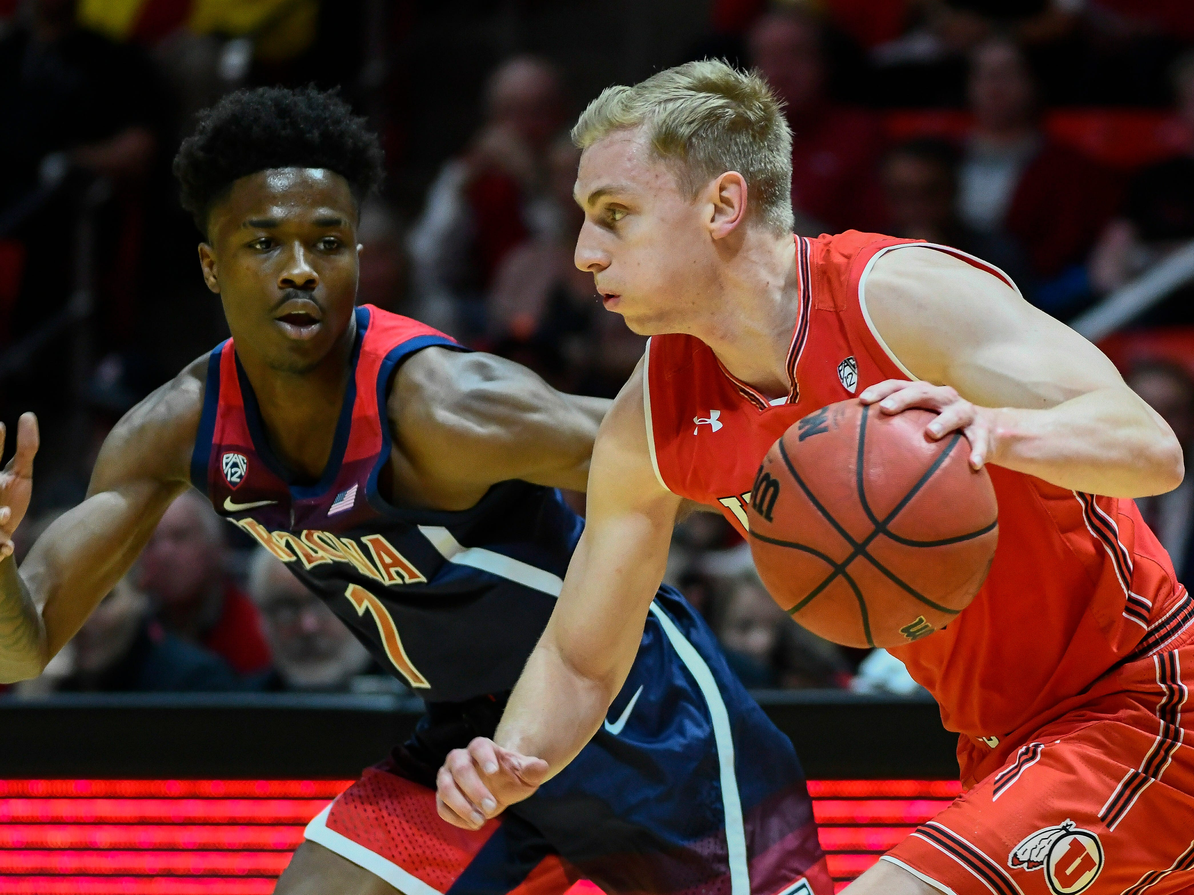 Arizona guard Devonaire Doutrive (1) defends Utah guard Parker Van Dyke, right, during the first half of an NCAA college basketball game Thursday, Feb. 14, 2019, in Salt Lake City.