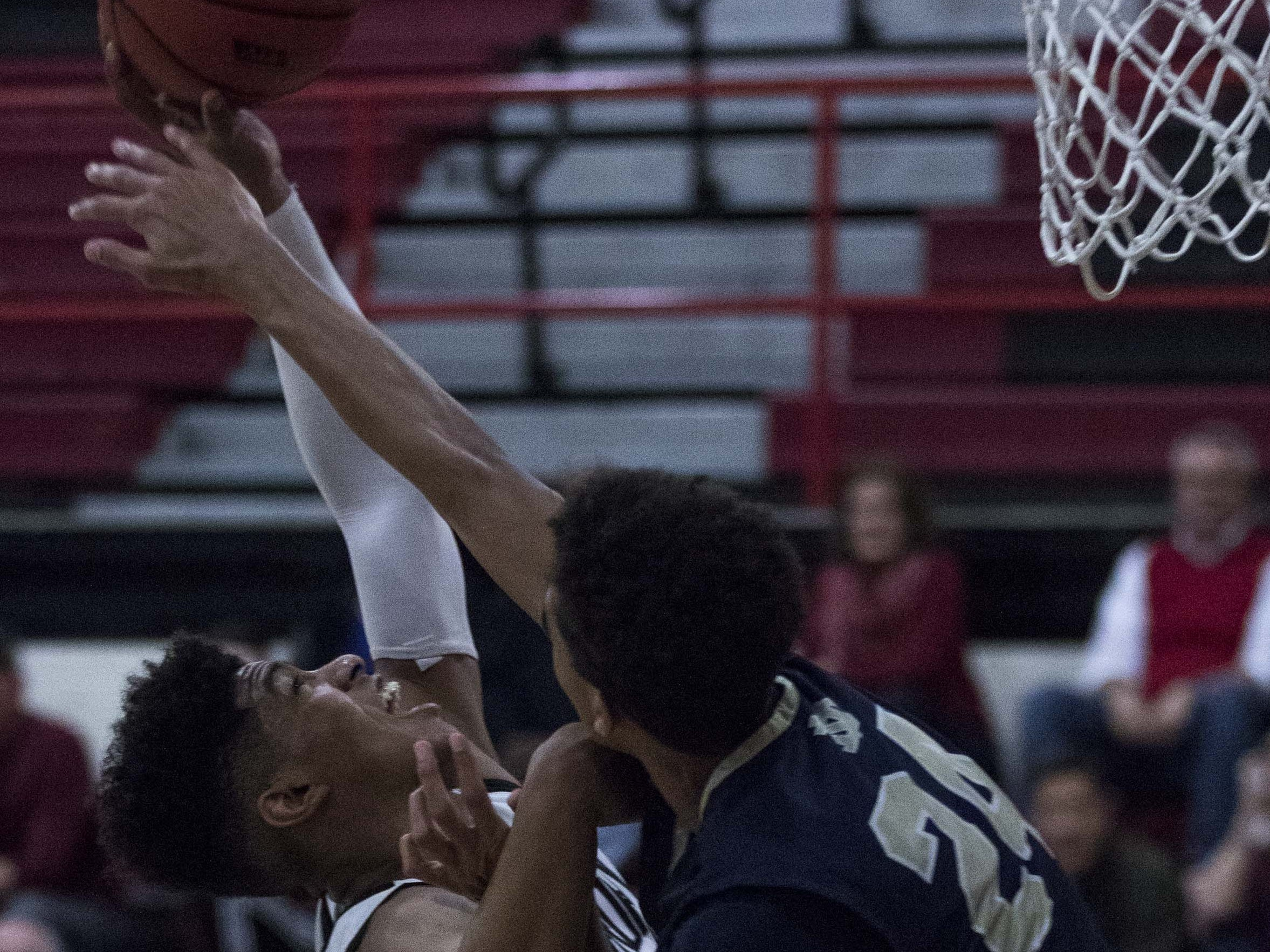 Brophy's Marques White(20) pulls down a rebound against Desert Vista's Osasere Ighodaro (24) during the second half of their game in Phoenix, Thursday, Feb .14,  2019.