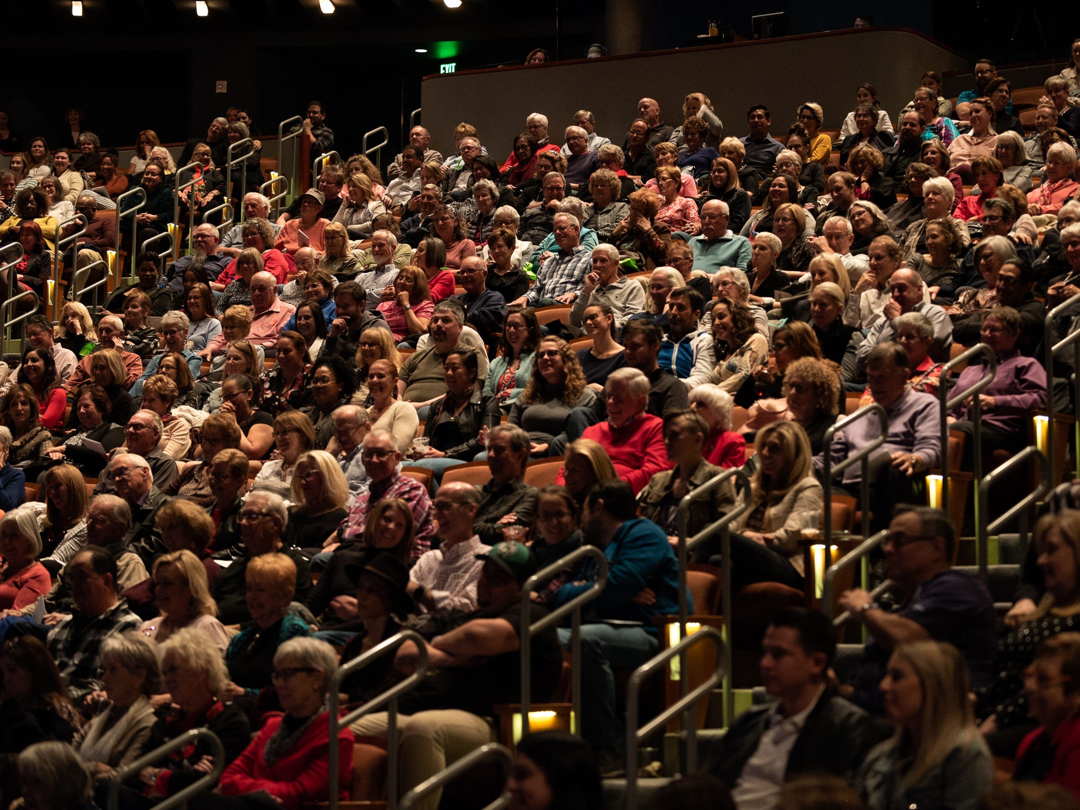 """The audience listens as storytellers share their tales during """"Arizona Storytellers: Romance or Not"""" at the Scottsdale Center for Performing Arts on Wednesday, Feb. 13, 2019."""