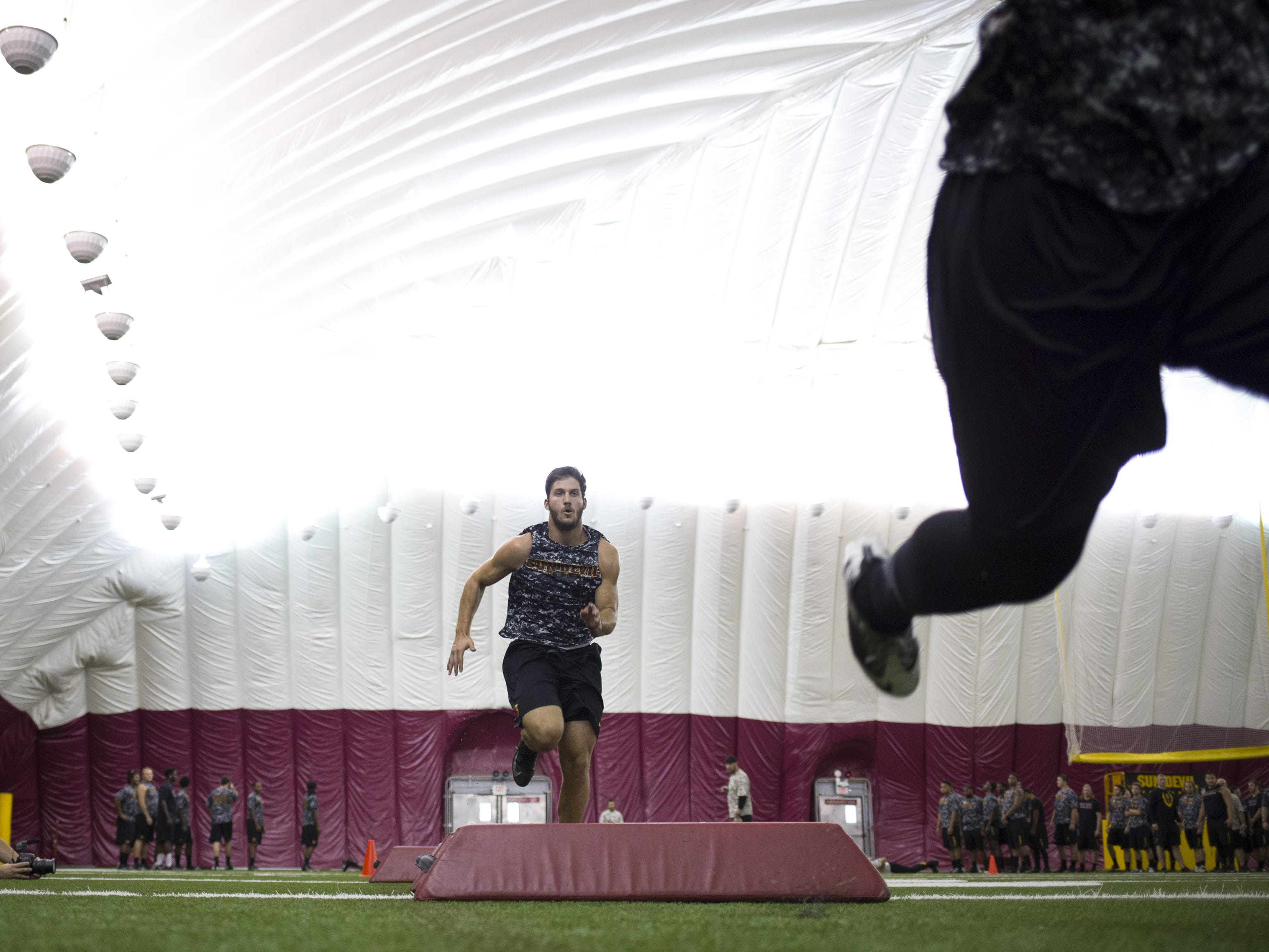 ASU tight end Kody Kohl participates in a running drill on July 25, 2014, at the Verde Dickey Dome.