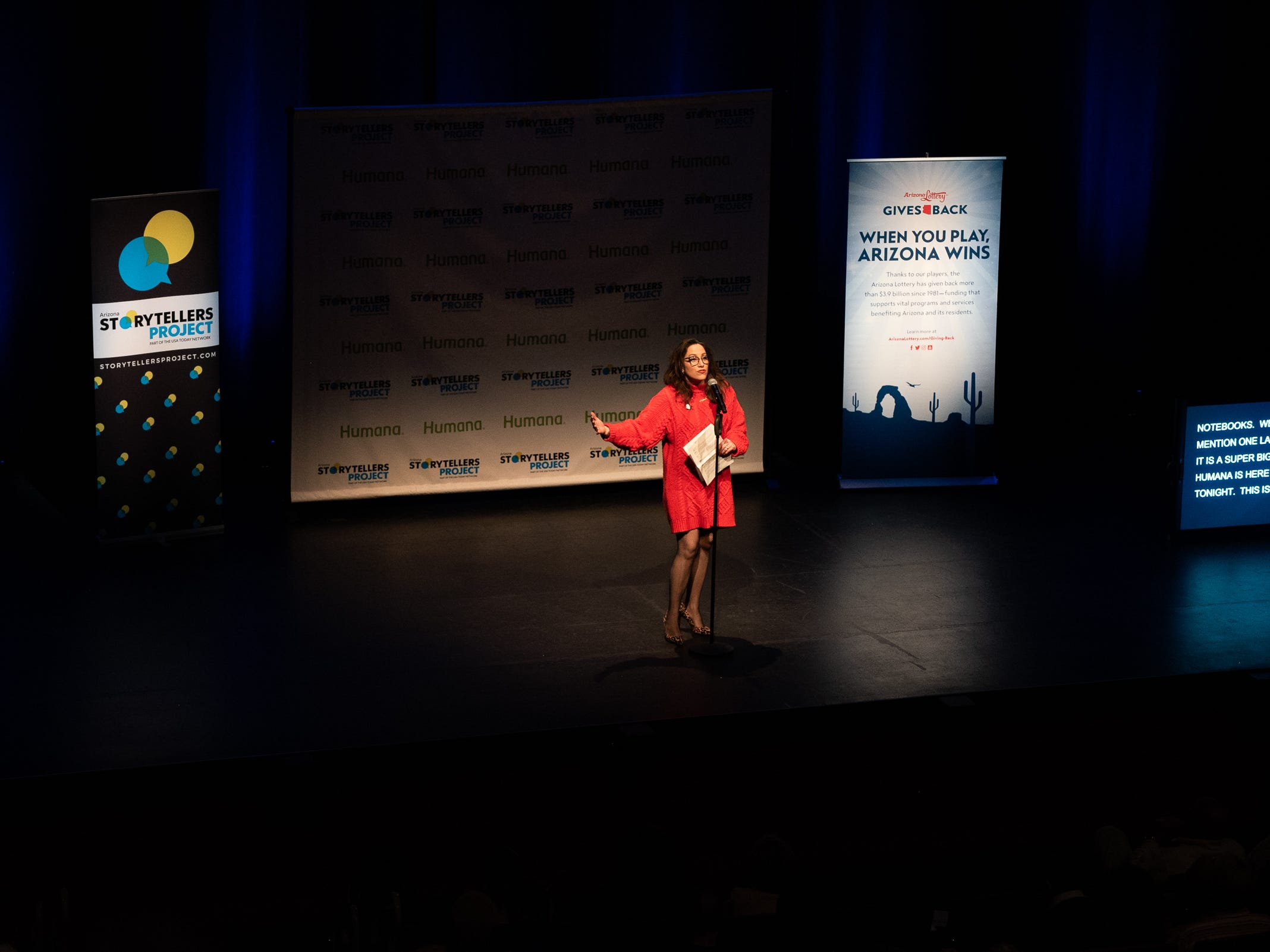 """Co-host Megan Finnerty warms up the crowd and announces the next storyteller during """"Arizona Storytellers: Romance or Not"""" at the Scottsdale Center for Performing Arts on Wednesday, Feb. 13, 2019."""