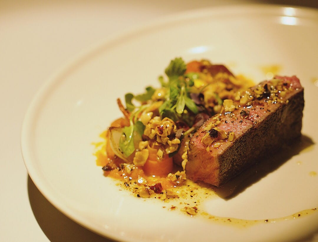 """Umami Rubbed NY Strip Steak with """"Carrots 3 Ways"""" from Hidden Kitchen chef Ivan Jacobo."""