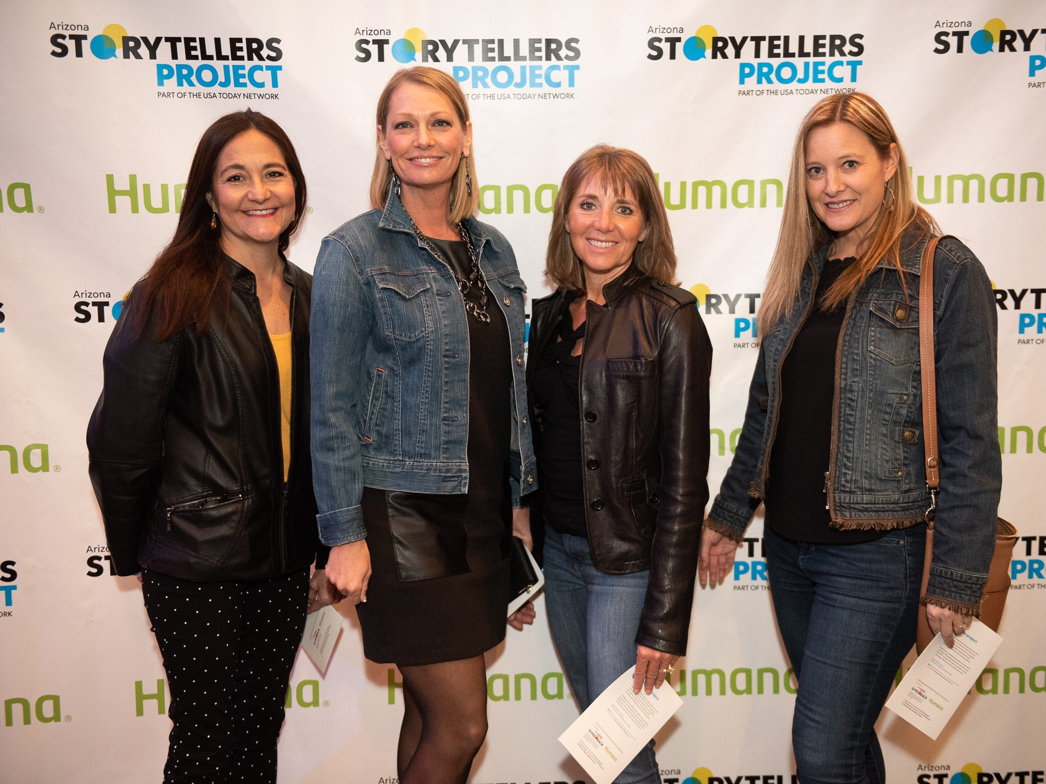 Attendees strike a pose at the Humana/Storytellers Project step and repeat during The Storytellers Project presents Romance - or Not at the Scottsdale Center for Performing Arts on Wednesday, Feb. 13, 2019.