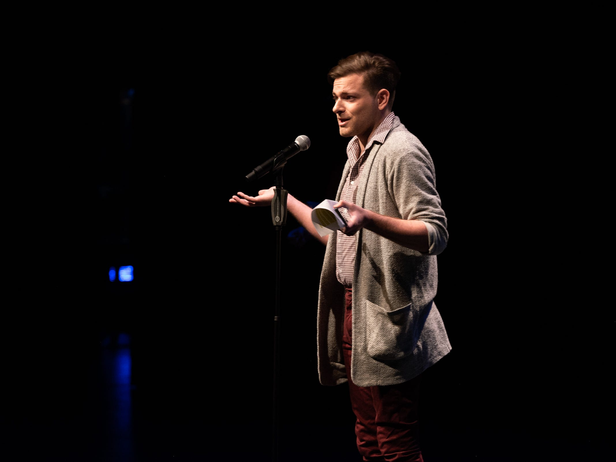 """Co-host Garrett Mitchell warms up the crowd and announces the next storyteller during """"Arizona Storytellers: Romance or Not"""" at the Scottsdale Center for Performing Arts on Wednesday, Feb. 13, 2019."""