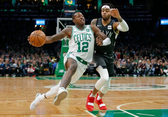 Boston Celtics point guard Terry Rozier and Brooklyn Nets point guard D'Angelo Russell (1) are on the list of the top potential free agent point guards in the NBA.