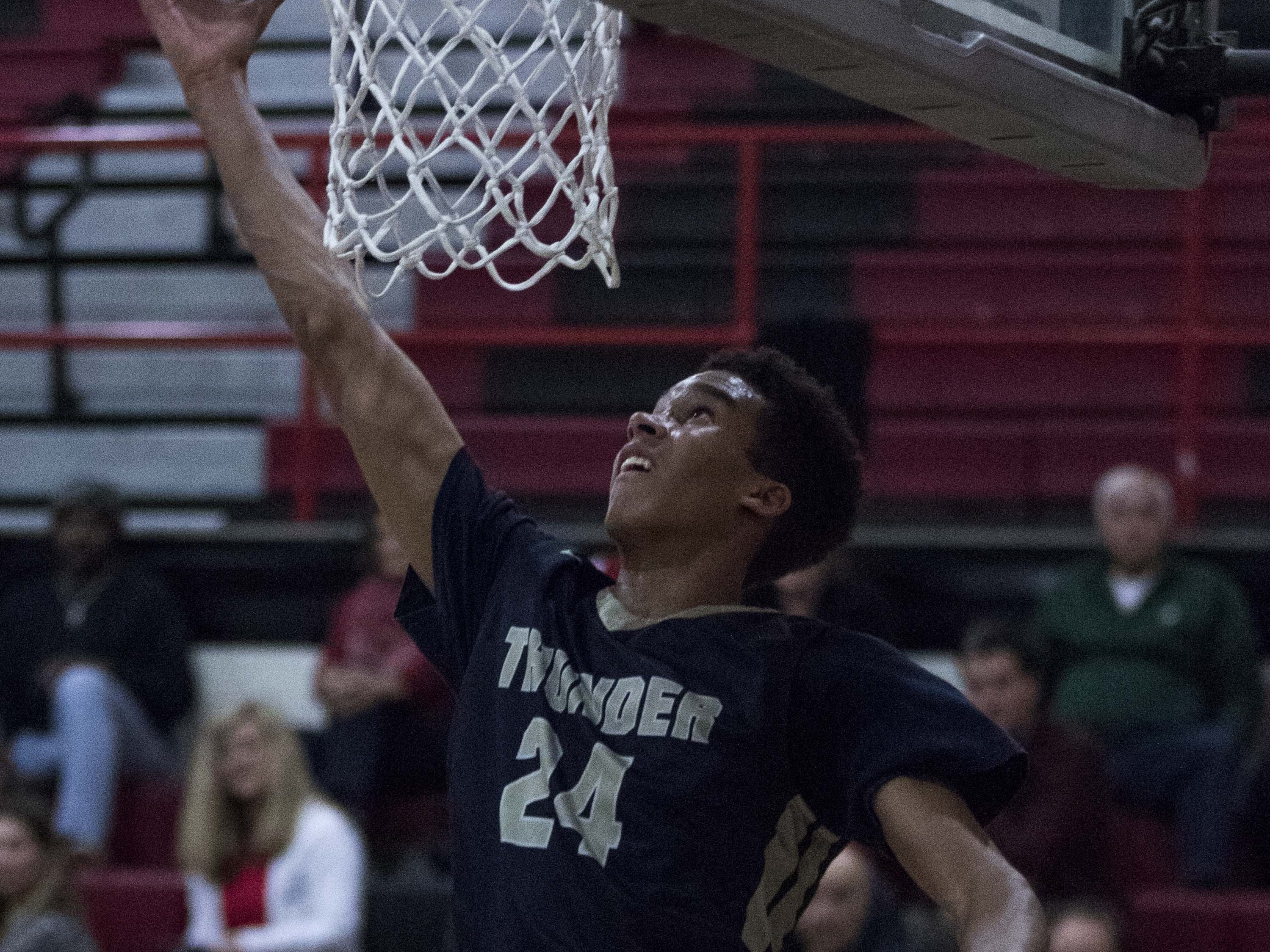 Desert Vista's Osasere Ighodaro (24) has an easy layup against Brophy during the second half of their game in Phoenix, Thursday, Feb .14,  2019.