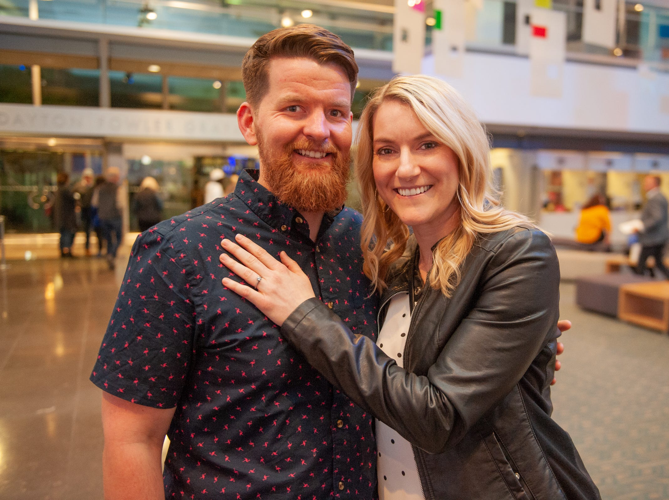 """Josh Shore and new fiancee Kristin Harris smile after she said yes to his proposal during """"Arizona Storytellers: Romance or Not"""" at Scottsdale Center for the Performing Arts in Scottsdale, Ariz., Wednesday, Feb. 13, 2019."""