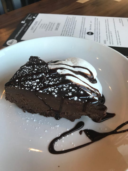NPX – A NEIGHBORHOOD JOINT: Get a freshly baked dessert on the house. Consider the mascarpone cheesecake or a fudgy gluten-free flourless chocolate cake.