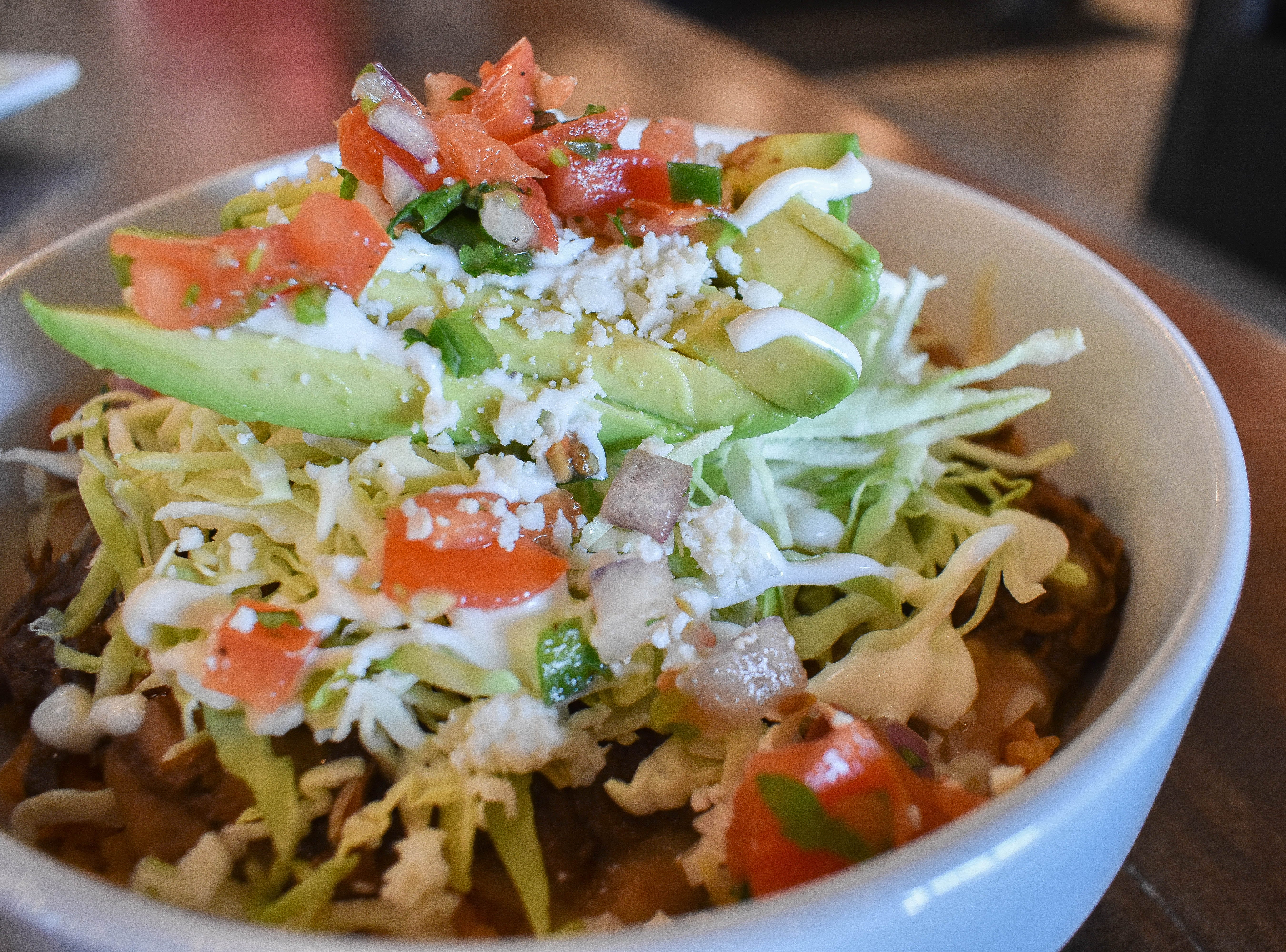 PAZ CANTINA: Buy one entree and get a secondfor half off. Wash it down with buy-one, get-one-for-a-penny draft beers.
