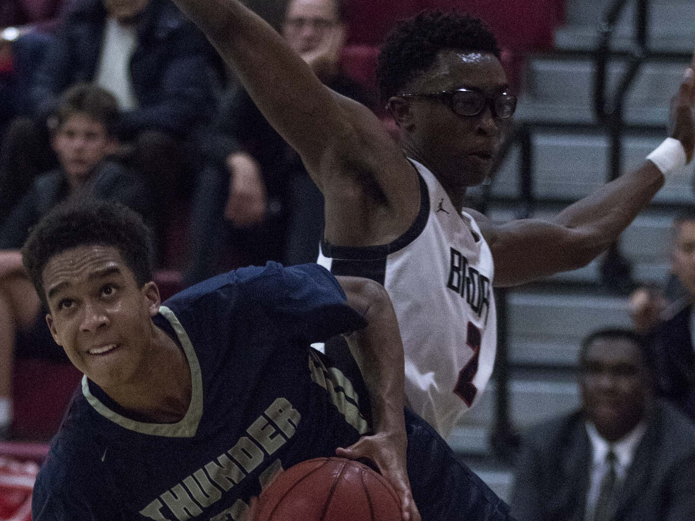 Desert Vista's Osasere Ighodaro (24) drives around Brophy's Basil Ribakare (2) as he eyes the basket during the second half of their game in Phoenix, Thursday, Feb .14,  2019.