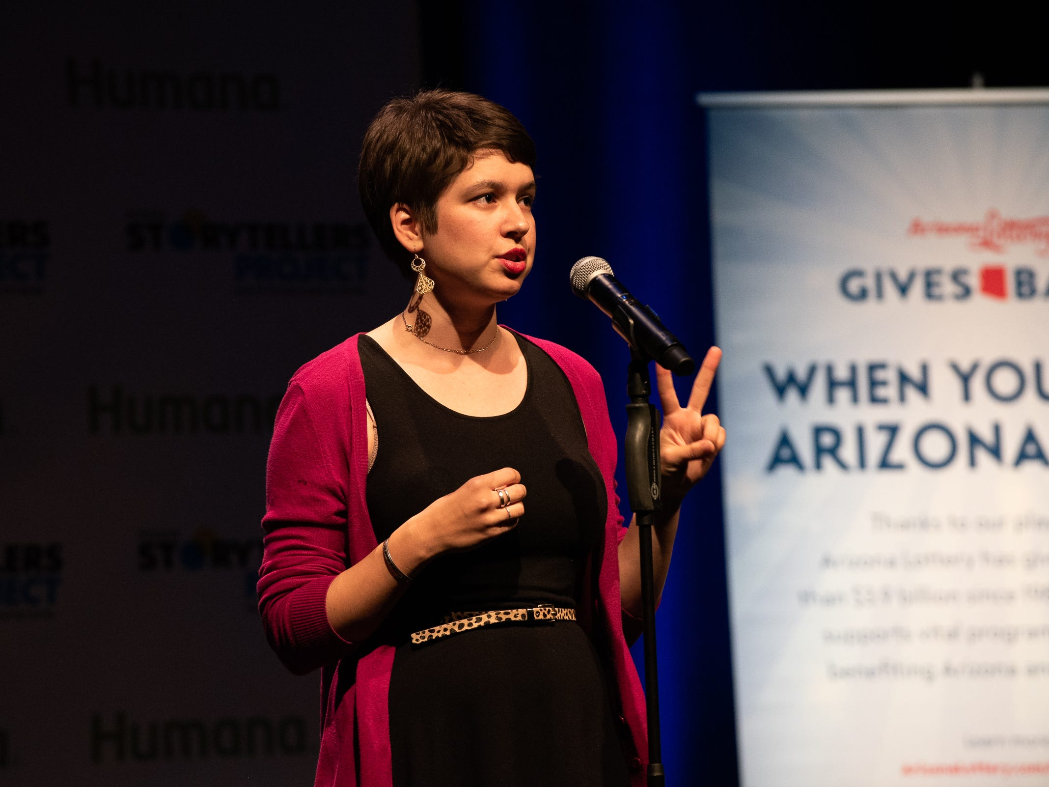 """Eva Jannotta tells her tale during """"Arizona Storytellers: Romance or Not"""" at the Scottsdale Center for Performing Arts on Wednesday, Feb. 13, 2019."""