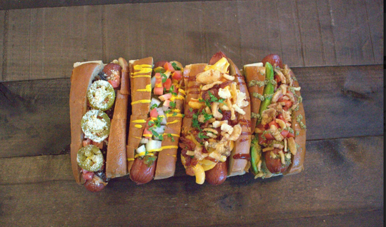 CHAR'D BRISKET DOGS + BURGERS: Get half off any brisket dog, burger or smoked sausage with the purchase of any drink.