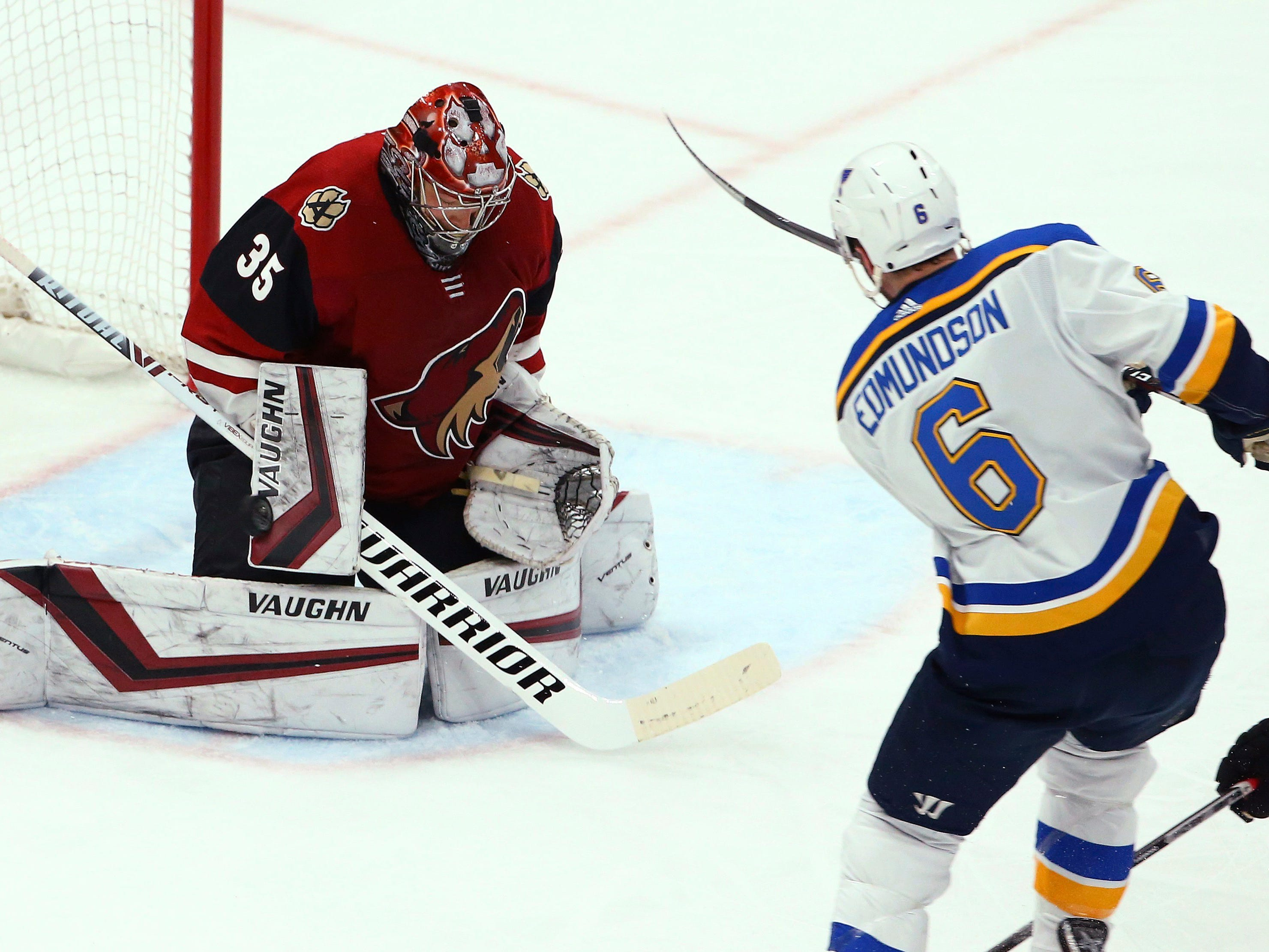 St. Louis Blues defenseman Joel Edmundson (6) sends the puck past Arizona Coyotes goaltender Darcy Kuemper (35) for a goal during the first period of an NHL hockey game Thursday, Feb. 14, 2019, in Glendale, Ariz.