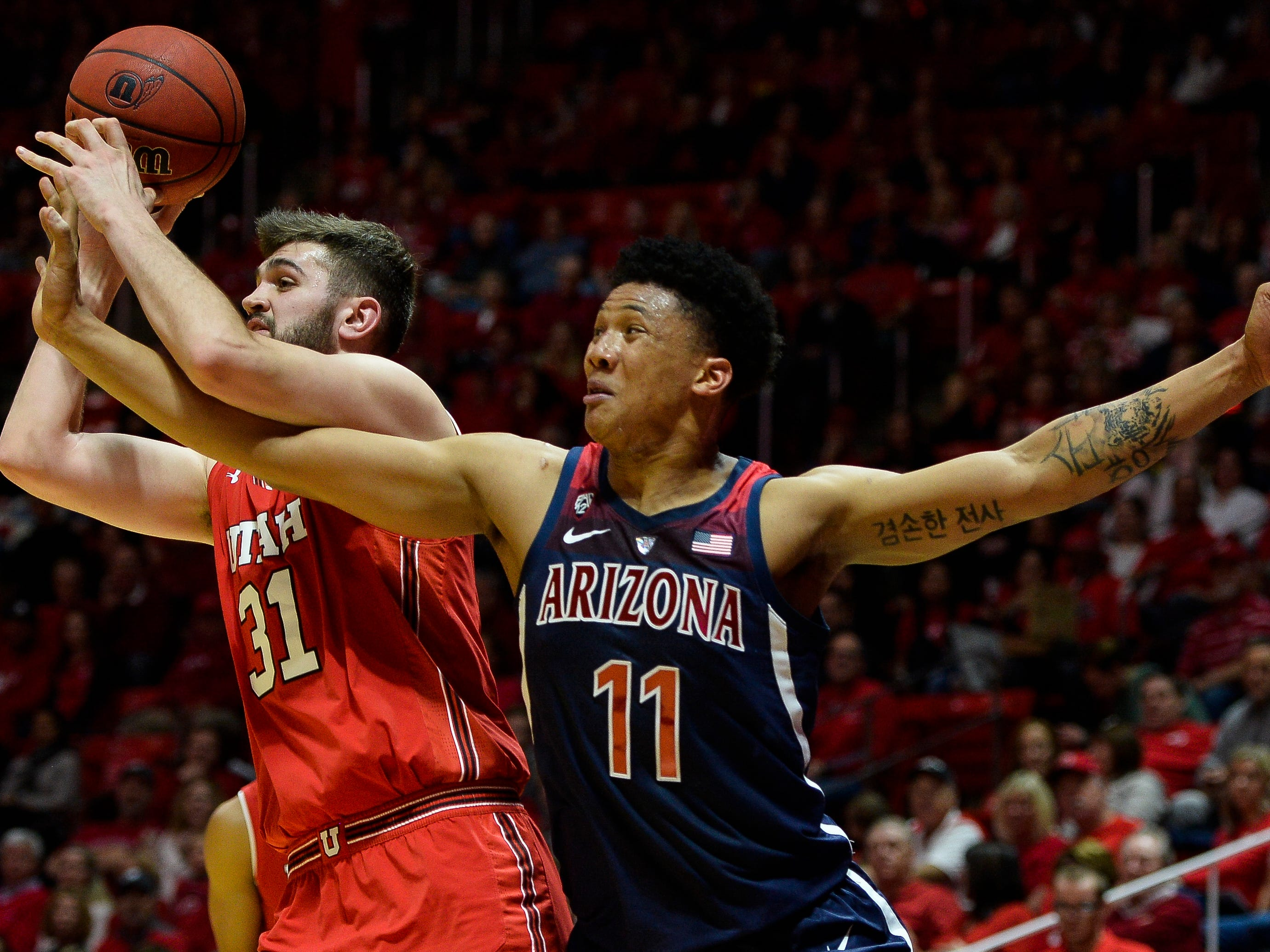 Utah center Brandon Morley (31) fights for the ball with Arizona forward Ira Lee (11) during the first half of an NCAA college basketball game Thursday, Feb. 14, 2019, in Salt Lake City.