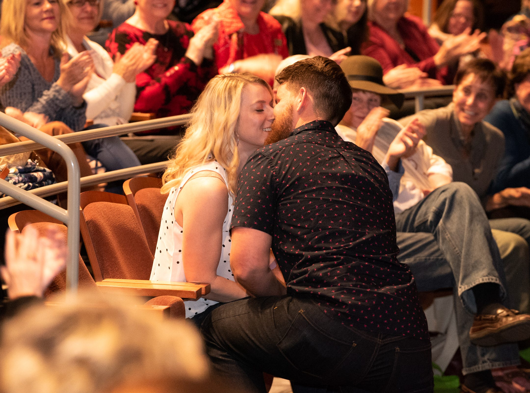 """Josh Shore surprises the audience by proposing to his girlfriend Kristin Harris during """"Arizona Storytellers: Romance or Not"""" at Scottsdale Center for the Performing Arts in Scottsdale, Ariz., Wednesday, Feb. 13, 2019."""