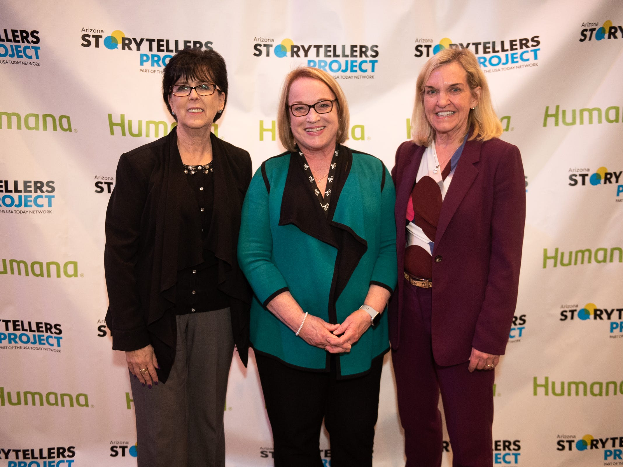 """Attendees strike a pose at the Humana/Storytellers Project step and repeat during """"Arizona Storytellers: Romance or Not"""" at the Scottsdale Center for Performing Arts on Wednesday, Feb. 13, 2019."""
