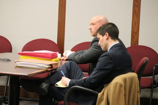Ottawa County Prosecutor James VanEerten, left, and Ohio Assistant Attorney General Micah Ault appear in court as three members of the McCann family, former Put-in-Bay elected officials, pleaded guilty to conflict of interest charges.