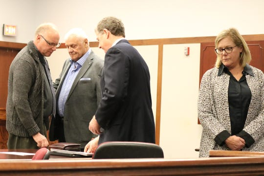 Michael McCann, Bernard McCann and Melinda McCann Myers, former Put-in-Bay elected officials, each pleaded guilty to two misdemeanor counts of conflict of interest in Ottawa County Municipal Court on Friday. They are joined by their defense attorney, John McCaffrey, center.