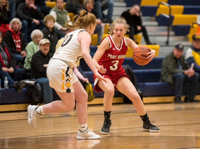 Port Huron Northern's Camille Keyes (10) moves in to steal the ball from Port Huron High School guard Madison Landschoot during an MAC tournament basketball game Thursday, Feb. 14, 2019 at Port Huron Northern High School.